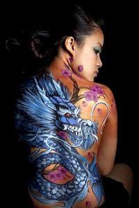 Сложное тату с драконом